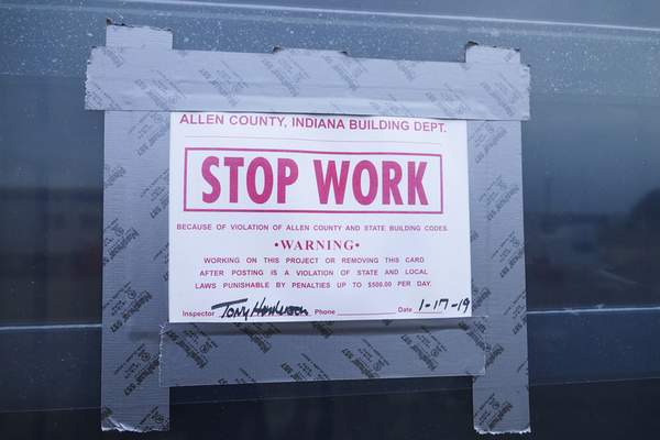 A stop-work order is posted Wednesday on a window at a hotel under construction off West Washington Center Road.