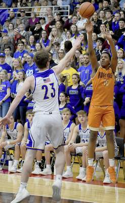 Rachel Von   The Journal Gazette  Northrop's Khamani Smith shoots over East Noble's Brent Cox in the first quarter of the Boys Basketball Sectional Finals at DeKalb on Saturday.