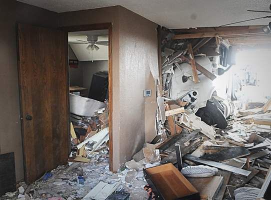 Truck plows into Rockford home