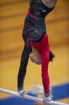 Fort Wayne Wayne High School gymnast Erica Xayarath competes on the bars during competition of the 47th Annual IHSAA Gymnastics State Finals at Noblesville High School in Noblesville, Ind. Saturday, March 9, 2019 . (Doug McSchooler/for Journal-Gazette)