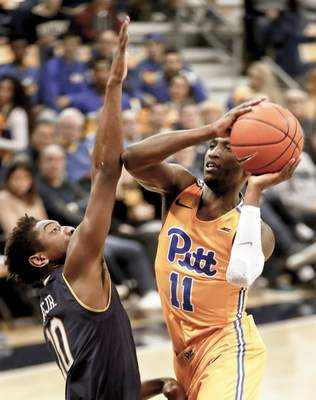 Pittsburgh's Sidy N'Dir (11) shoots over Notre Dame's TJ Gibbs (10)during the first half of an NCAA college basketball game, Saturday, March 9, 2019, in Pittsburgh. (AP Photo/Keith Srakocic)