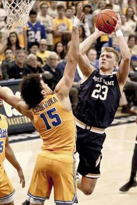 Notre Dame's Dane Goodwin (23) shoots over Pittsburgh's Kene Chukwuka (15) during the second half of an NCAA college basketball game, Saturday, March 9, 2019, in Pittsburgh. (AP Photo/Keith Srakocic)