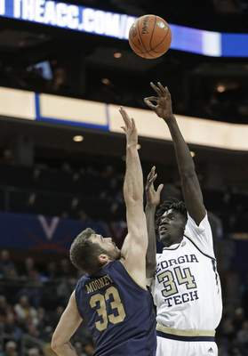 Georgia Tech's Abdoulaye Gueye (34) shoots over Notre Dame's John Mooney (33) during the first half of an NCAA college basketball game in the Atlantic Coast Conference tournament in Charlotte, N.C., Tuesday, March 12, 2019. (AP Photo/Nell Redmond)
