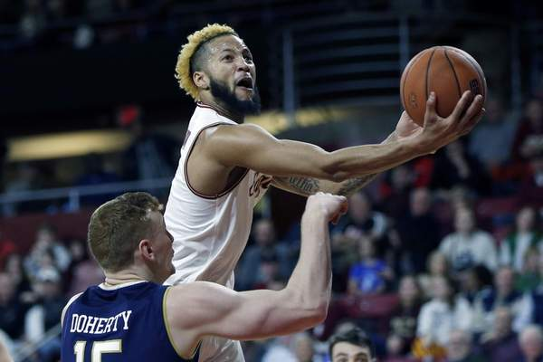 FILE - In this Feb. 2, 2019, file photo, Boston College's Ky Bowman shoots over Notre Dame's Chris Doherty (15) during the first half of an NCAA college basketball game, in Boston. Bowman was named to the AP All-ACC team, Tuesday, March 12, 2019.(AP Photo/Michael Dwyer, File)