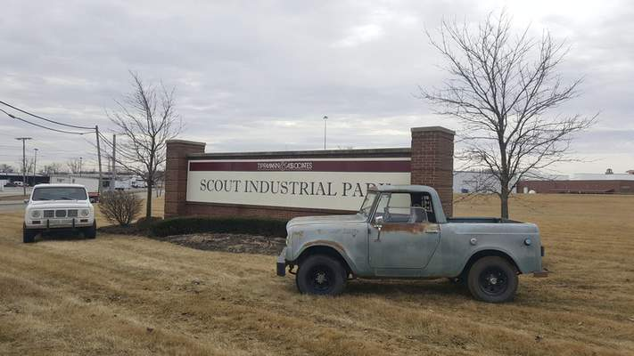 Ryan DuVall | The Journal Gazette  A pair of Scouts, a 1976 Traveler on the left and a 1968 800, in front of the the Scout Industrial Park sign, site of the Scout factory, at Meyer Road and New Haven Avenue. An all-Harvester truck show and celebration of the former Harvester workers will be held here on August 10 with hopes of raising funds for a charity dedicated to Harvester's history in Fort Wayne.