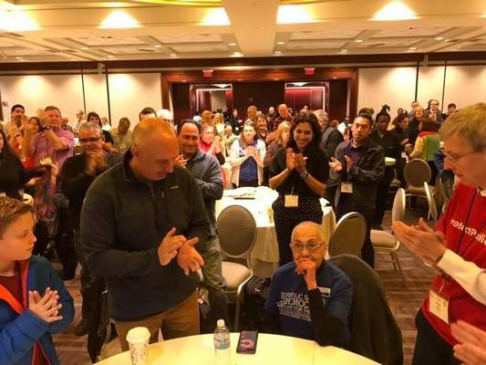 Courtesy of Anthony Cody Phyllis Bush, seated, accepts congratulations after the Network for Public Education announced a grassroots activism award in her honor during itsnationalconference in Indianapolis in October.Wife Donna Roofis at right; grandson Aiden Bush and son David Bush are at left.
