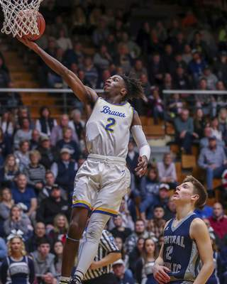Jeff Douglas | For The Journal Gazette Blackhawk Christian senior guard Trinity Clark says the team is a close-knit group that likes to hang out together.