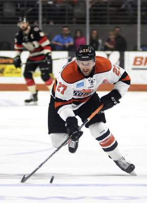 Katie Fyfe | The Journal Gazette  Komets' Shawn Szydlowski carries the puck during the first period against the Cincinnati Cyclones at Memorial Coliseum on Friday.