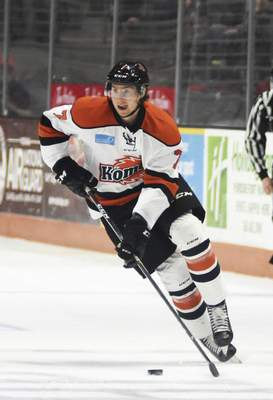 Katie Fyfe | The Journal Gazette  Komets' Sean Flanagan carries the puck during the first period against the Cincinnati Cyclones at Memorial Coliseum on Friday.