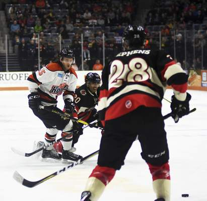Katie Fyfe | The Journal Gazette  Komets' J.C. Campagna chases the puck during the second period against the Cincinnati Cyclones at Memorial Coliseum on Friday.