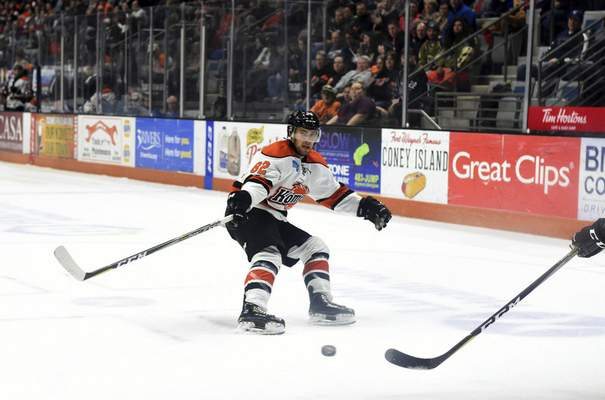 Katie Fyfe | The Journal Gazette  Komets' Anthony Nellis defends the puck during the first period agianst the Cincinnati Cyclones at Memorial Coliseum on Friday.
