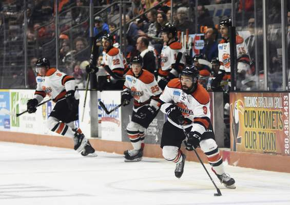 Katie Fyfe | The Journal Gazette  Komets' Mason Baptista carries the puck during the first period against the Cincinnati Cyclones at Memorial Coliseum on Friday.