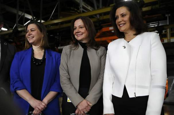 Following her Friday announcement, Barra has her picture taken alongside U.S. Rep. Elissa Slotkin, left, and Michigan Gov. Gretchen Whitmer.