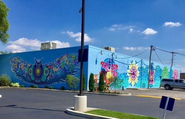 AFTER: Jerrod Tobias' work now adorns the building, which also houses Health Food Shoppe and Studio Seva.