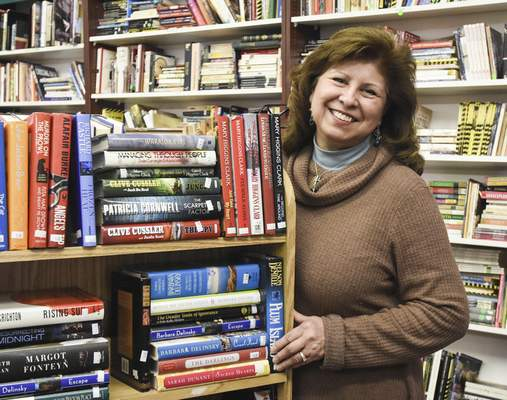 Michelle Davies | The Journal Gazette After 26 years of owning The Bookmark, 3420 N. Anthony Blvd., Lanni Ruiz Connelly is retiring.
