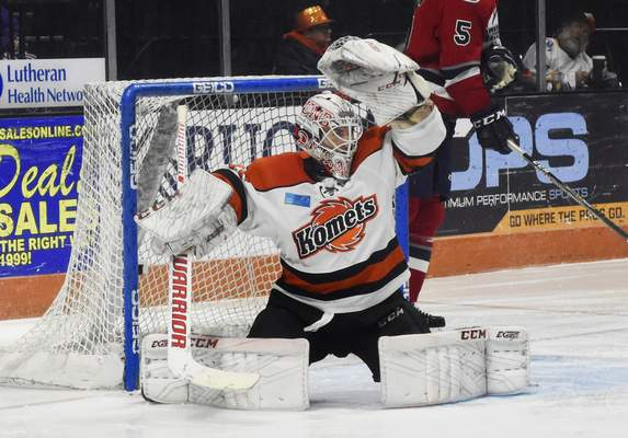 Rachel Von | The Journal Gazette  Komets goalie Alex Dubeau catches a puck during the second period against the Wings at the Memorial Coliseum on Wednesday.