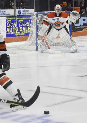 Rachel Von | The Journal Gazette  Komets goalie Alex Dubeau watches for the puck during the second period against the Wings at the Memorial Coliseum on Wednesday.