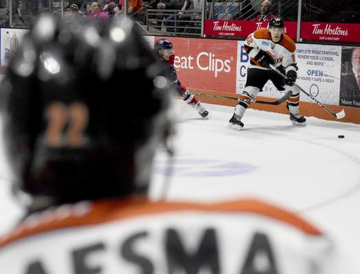 Rachel Von | The Journal Gazette  The Komets' Anthony Nellis passes the puck to Jamie Schaafsma during the first period against the Wings at the Memorial Coliseum on Wednesday.