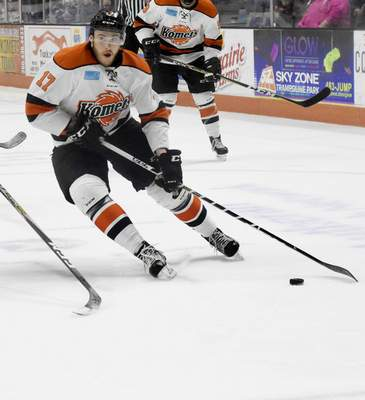 Rachel Von | The Journal Gazette  The Komets' Reid Jackman skates the puck through players during the first period against the Wings at the Memorial Coliseum on Wednesday.