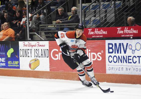 Katie Fyfe | The Journal Gazette  The Komets' Jake Kamrass carries the puck during the first period against the Kansas City Mavericks at Memorial Coliseum on Saturday.