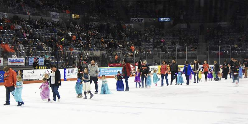 Katie Fyfe | The Journal Gazette  The rink gets filled with princesses for the Princess Parade during the first period intermission during the Komets vs. Mavericks game at Memorial Coliseum on Saturday.