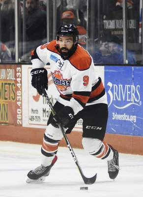 Katie Fyfe | The Journal Gazette  Komets' Mason Baptista carries the puck during the first period against the Kansas City Mavericks at Memorial Coliseum on Saturday.