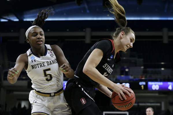 Stanford's Alanna Smith (11) grabs a rebound against Notre Dame's Jackie Young (5) during the first half of a regional championship game in the NCAA women's college basketball tournament, Monday, April 1, 2019, in Chicago. (AP Photo/Kiichiro Sato)