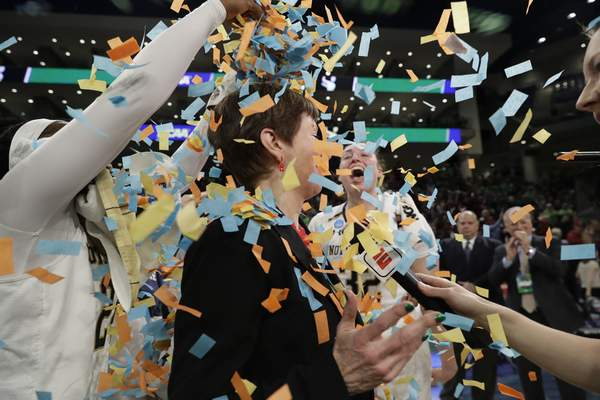 Notre Dame head coach Muffet McGraw celebrates with her team after defeating Stanford 84-68 in a regional championship game in the NCAA women's college basketball tournament, Monday, April 1, 2019, in Chicago. (AP Photo/Nam Y. Huh)