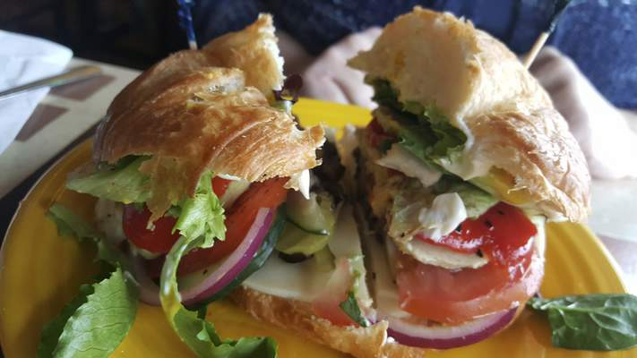 A veggie sandwich on a croissant at Firefly Coffee House on North Anthony Boulevard.