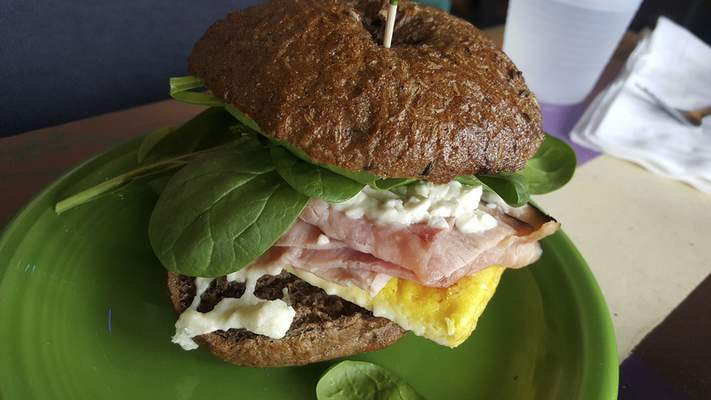 A breakfast sandwich on a house-made rye bagel at Firefly Coffee House on North Anthony Boulevard.