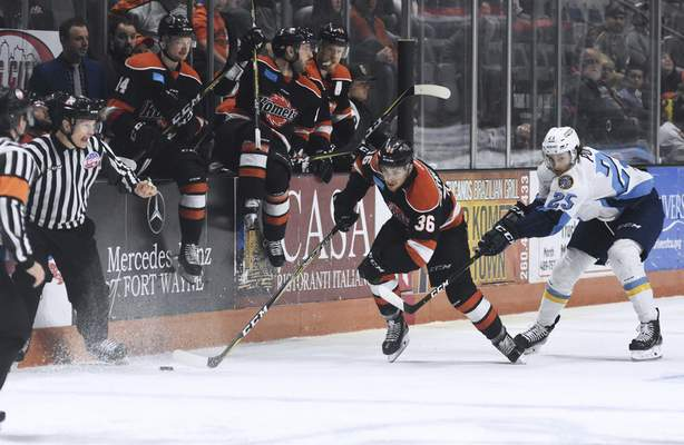 Katie Fyfe | The Journal Gazette Komets' Anthony Petruzzelli chases after the puck while Toledo Walleye's David Pope tries to stop him during the second period at Memorial Coliseum on Friday April 19th, 2019.