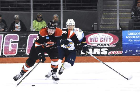 Katie Fyfe | The Journal Gazette Komets' Josh Elmes carries the puck while Toledo Walleye's Greg Wolfe tries to stop him during the first period at Memorial Coliseum in Fort Wayne on Friday April 19th, 2019.