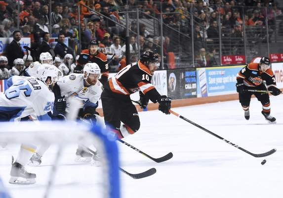 Katie Fyfe | The Journal Gazette Komets' Brady Shaw chases the puck during the first period against the Toledo Walleye at Memorial Coliseum in Fort Wayne on Friday April 19th, 2019.