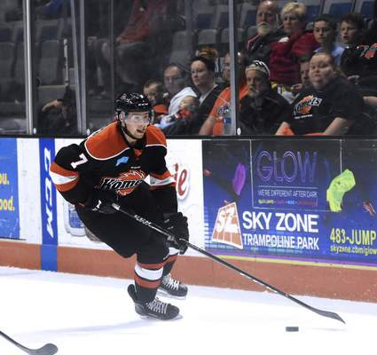 Katie Fyfe | The Journal Gazette Komets' Sean Flanagan carries the puck during the first period against the Toledo Walleye at Memorial Coliseum in Fort Wayne on Friday April 19th, 2019.