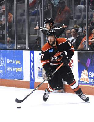 Katie Fyfe | The Journal Gazette Komets' Shawn Szydlowski looks for someone to pass the puck to during the first period against the Toledo Walleye at Memorial Coliseum in Fort Wayne on Friday April 19th, 2019.