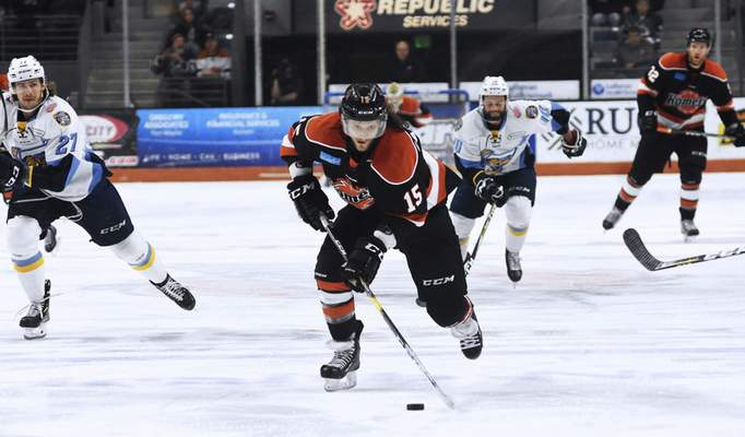 Katie Fyfe | The Journal Gazette Komets' J.C. Campagna carries the puck during the first period against the Toledo Walleye at Memorial Coliseum in Fort Wayne on Friday April 19th, 2019.