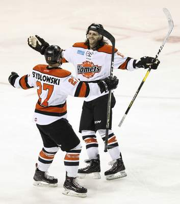 Komets forward J.C. Campagna, right, celebrates with Shawn Szydlowski after scoring a goal Saturday night in Toledo.