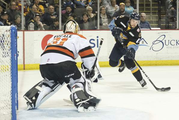Jeremy Wadsworth | The Blade  Toledo Walleye forward Dylan Sadowy takes as shot on Komets goalie Zachary Fucale during the first period of Game 5 of the Central Division semifinals at the Huntington Center in Toledo, Ohio.
