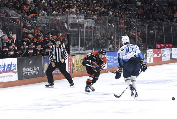 Katie Fyfe | The Journal Gazette  The Komets' Kevin Gibson defends the puck during the second period against the Toledo Walleye at Memorial Coliseum on Friday.