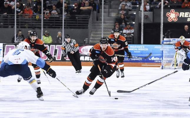Katie Fyfe | The Journal Gazette  The Komets' Kyle Hope steals the puck during the first period against the Toledo Walleye at Memorial Coliseum on Friday.