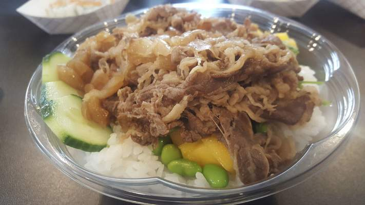 A beef bowl with white rice at AA Poke on Coliseum Boulevard.