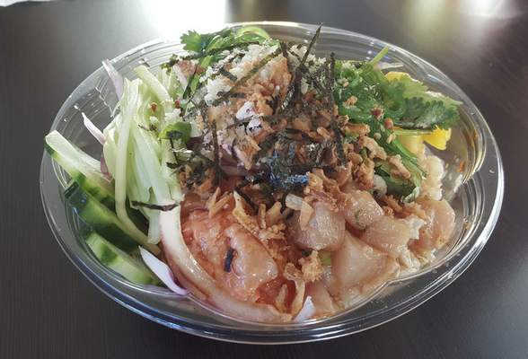 A marinated yellowtail bowl with brown rice at AA Poke on Coliseum Boulevard.