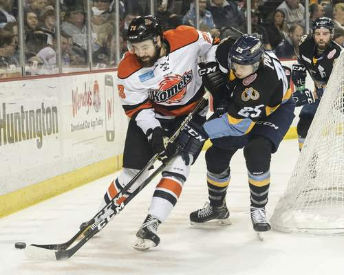 Jeremy Wadsworth | The Blade  Komets defenseman Chase Stewart moves the puck against Toledo Walleye forward Davis Pope (25) during the first period of Game 5 of the Central Division semifinals at the Huntington Center in Toledo, Ohio.