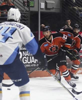 Katie Fyfe | The Journal Gazette  Komets' Shawn Szydlowski carries the puck during the second period against the Toledo Walleye at Memorial Coliseum on Tuesday.