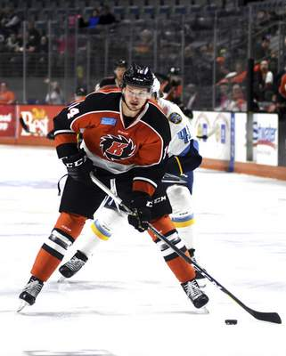 Katie Fyfe | The Journal Gazette  Komets' Kyle Hope looks for where to pass the puck during the first period against the Toledo Walleye at Memorial Coliseum on Tuesday.