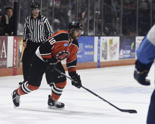 Katie Fyfe | The Journal Gazette  Komets' Brady Shaw carries the puck during the second period against the Toledo Walleye at Memorial Coliseum on Tuesday.