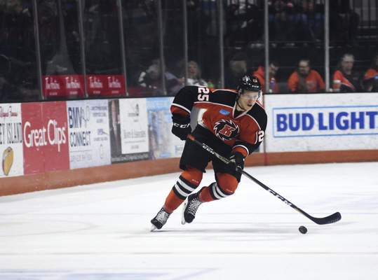 Katie Fyfe | The Journal Gazette  Komets' Jake Kamrass carries the puck during the second period against the Toledo Walleye at Memorial Coliseum on Tuesday.