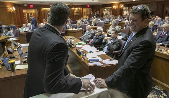 Lawmakers attend the final scheduled day of the legislative session at Indiana Statehouse in Indianapolis, Wednesday. (Associated Press)