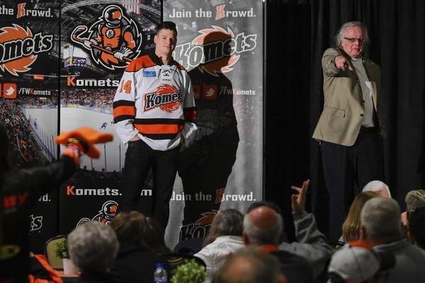 Mike Moore | The Journal Gazette A hockey fan places a bid on Komets forward Kyle Hope's jersey, center joined by team president Michael Franke on stage during the team's End-of-Season Party and Jersey Auction at Memorial Coliseum on Thursday. Kyle's jersey sold for $1,250 and went to Brent McKown.