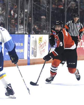 Katie Fyfe | The Journal Gazette  Komets' Mason Baptista carries the puck during the second period against the Toledo Walleye at Memorial Coliseum on Tuesday.